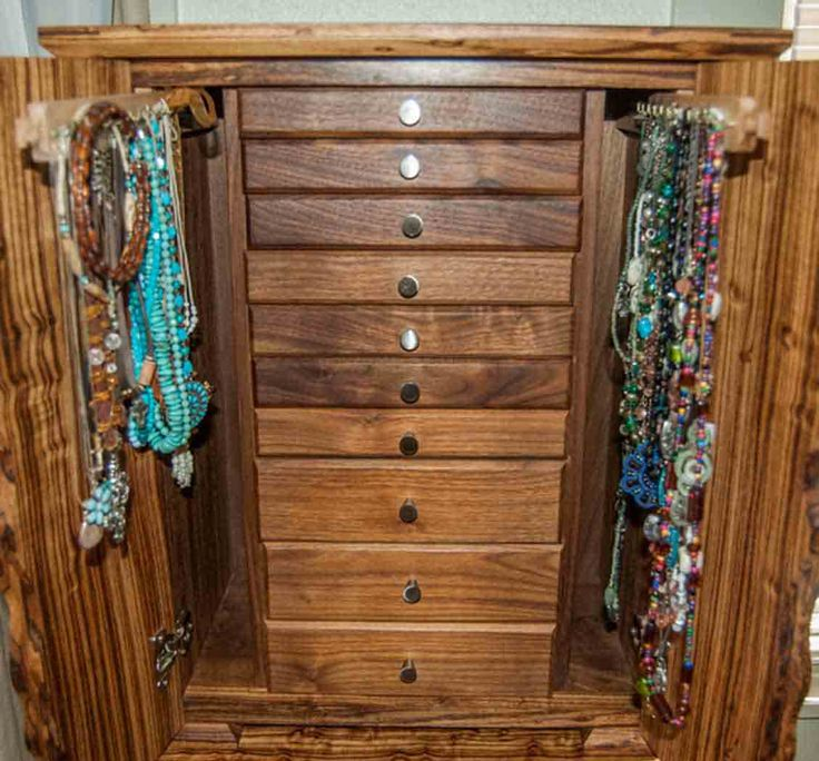 This gorgeous necklace jewelry box stores dozens of necklaces while also serving as a beautiful piece of artful decor.