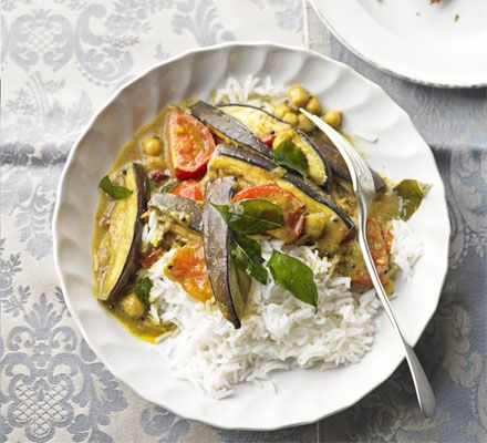 With golden aubergine, fresh tomatoes and a fragrant coconut sauce, this veggie curry's a surefire summertime winner