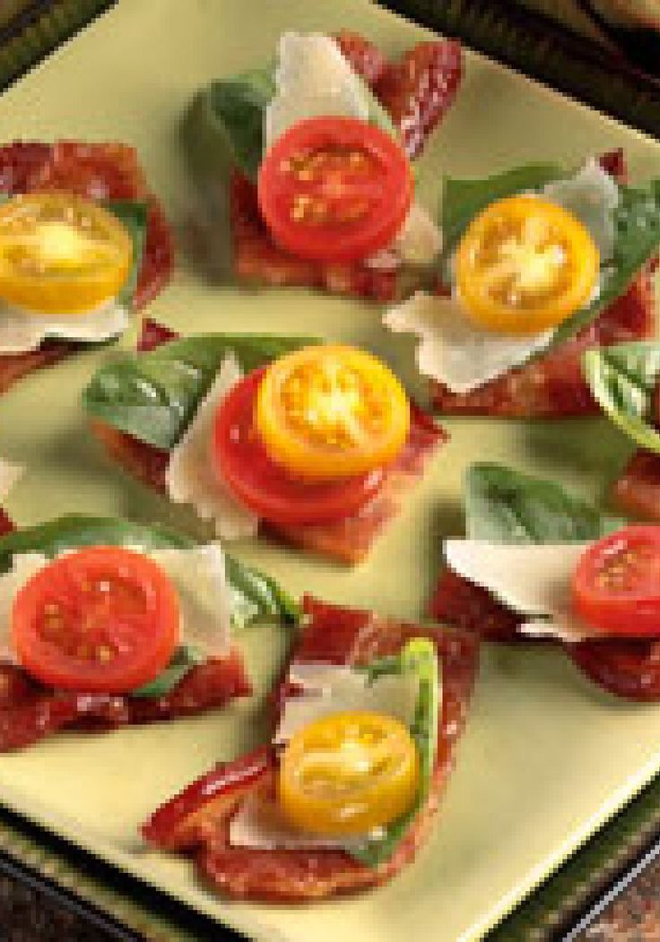 """Balsamic Bacon """"Bruschetta"""" -- In this hearty take on traditional bruschetta recipes, ditch the bread altogether and serve the topping directly on the balsamic coated bacon."""