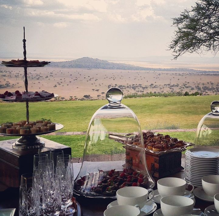 Taking a break for a cup of tea and delicious treats at Singita Sasakwa Lodge...