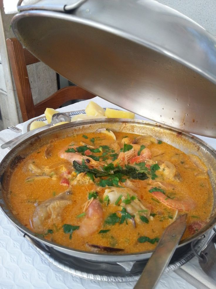 Oh and you cannot miss trying one of Algarve's famous Cataplanas - fish or meat stew cooked in a cataplana pot, this one was made with tambo... by Andrea Smith @Andrea Smith An American in Portugal, Portuguese Food, Wine & Travel writer, Lisbon tour guide & Catavino blogger.