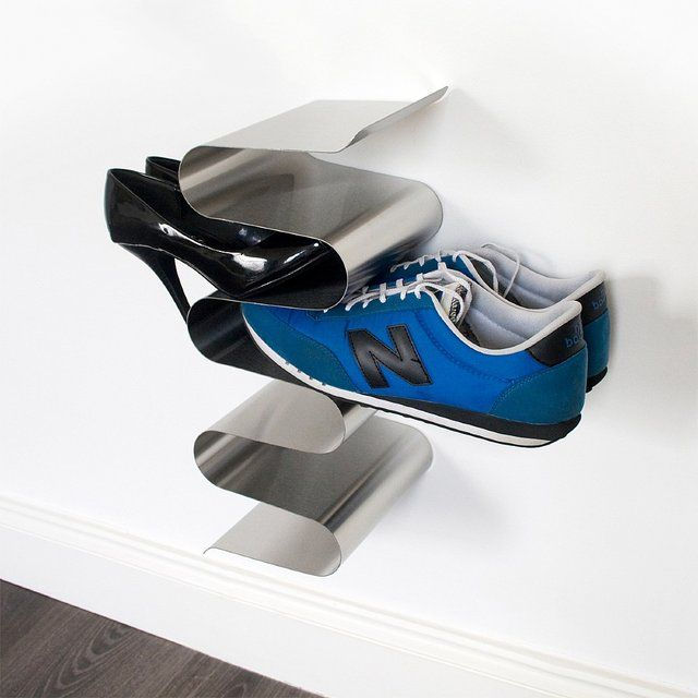 This wall mounted Shoe Rack keeps your shoes truly out of the way. Convenient & super sleek design allows you to grab your shoes quickly. Suitable for mens, womens & childrens shoes. Brushed finish. Stackable. Attach to wall using 3 supplied screws. Stainless steel. Easy to clean. Holds 6 pairs of shoes. 150 x 190 x 403mm./ Weight: 1.9kg. Please allow 2-3 weeks for shipping.
