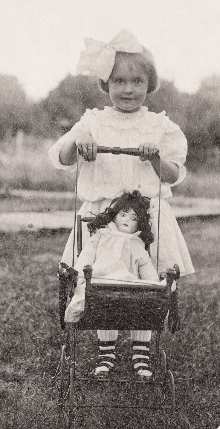Little Girl With Big Bow And Buggy