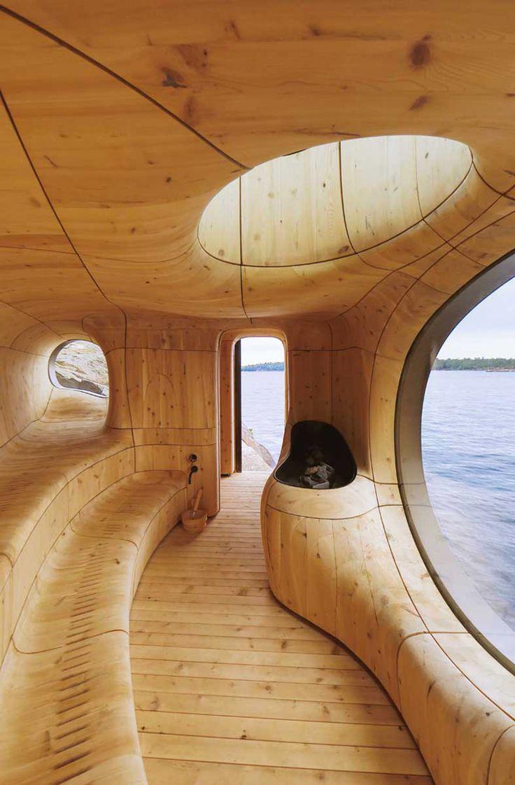 Perché sur le bord nord-ouest d'une île privée, à quelques kilomètres de Toronto, la Grotte sauna est un espace sculpté par le studioPartisans