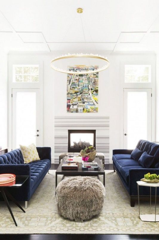Domino magazine shares ideas for having a blue couch in your home. Shop the blue couch trend on domino.com.