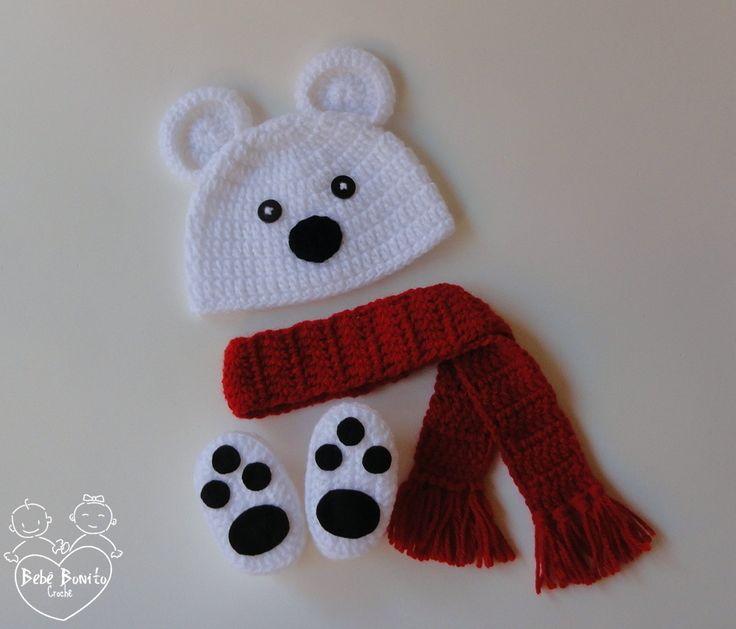 """Conjunto Ursinho Polar composto por: Touca, sapatinhos e cachecol em crochê. <br> <br>Faixa de tamanhos (circunferência): <br> <br>RN (34-36cm) <br> <br>1-3 meses (38-40cm) <br> <br>3-6 meses (42-44cm) <br> <br>ATENÇÃO: - Por favor, informe o tamanho desejado do produto em """"Contatar vendedor"""" durante a compra; <br> <br>- O prazo de confecção começará a ser contado a partir da confirmação do pagamento. <br> <br>NOTA: - As cores dos produtos serão as mesmas das apresentadas no anúncio, porém…"""