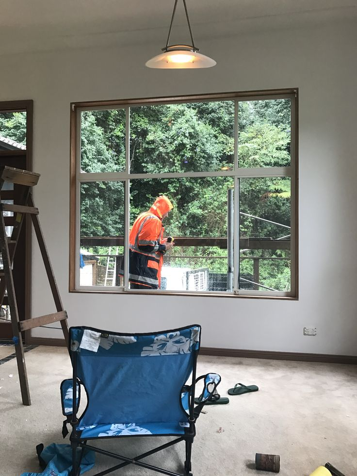 Von Cell working rain or shine to get the exterior paint done...check out dated window framing soon to be gone!