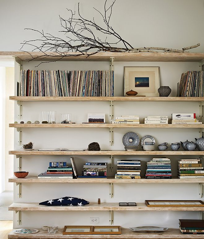Built-in bookshelves in the living room hold Sanders's vinyl collection.   Photo by Caren Alpert.