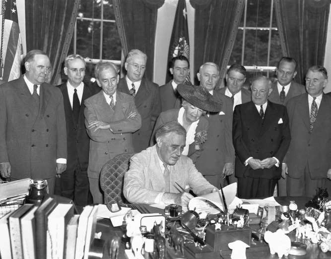 June 22,  1944: FDR SIGNS G.I. BILL  -   President Roosevelt signs the 'G.I.Bill of Rights' which provides broad benefits for veterans of World War II.