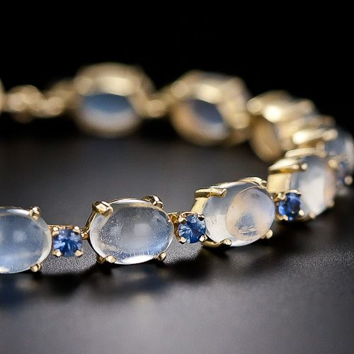 Moonstone and Sapphire Bracelet Fifteen shimmering, horizontally-set moonstones, with distinct bluish overtones, alternate with bright, electric-blue Montana sapphires in this mid-century lunar beauty. 14k Gold.