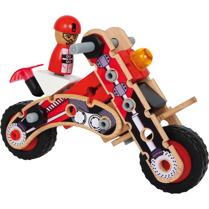 """Jucărie din lemn """" Motocicleta de curse"""", o jucărie potrivită pentru vitorii motocicliști! Kitul de construcție al motocicletei este fabricat din lemn de fag fin lustruit, conține șuruburi, elemente din plastic și lemn lăcuit care pot fi asamblate de degetele bine antrenate. Reprodus până la cele mai mici detalii, garantează o distracție de vis!"""