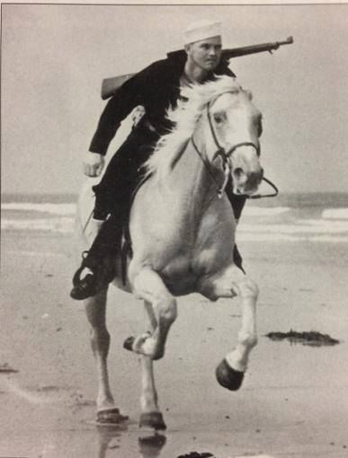 """During the war, the Coast Guard Beach Patrol covered more than 3,700 mile of coast and employed about 24,000 men. Patrols on horseback worked in pairs, riding about 100 feet apart, usually covering a 2-mile stretch. They were called """"Sand Pounders"""" and were able to cover difficult terrain quickly and efficiently. c 1945 ~"""