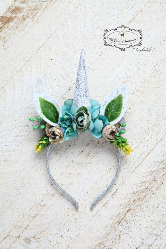 b41bbe0f9b9    Unicorn headband    This lovely unicorn headband adorned with flowers  and moss is designed for a style photo session