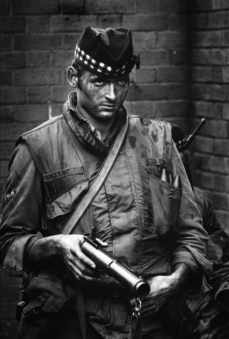 """""""This [British] soldier was facing a hostile crowd of youngsters and, for a moment, his expression revealed his disdain.""""  Northern Ireland - 1972  (Photo byPhilip Jones Griffiths)"""