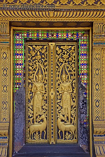 The doors are so finely detailed. the colors surrounding the main door are also of bright colors, so that it could be easily identified by anyone who might walk past it, to stop and admire the door.