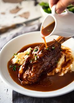 Braised lamb shanks slow cooked in an incredible port sauce. Simple to make, on the stove, slow cooker or oven. The rich, thick sauce is incredible!
