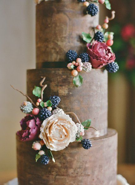 Organic and natural wedding cake with chocolate ganache, ruffles, and handmade sugar blackberries, hypericum berries and peonies, created by Sweet and Swanky Cakes in Bend, OR. Photo by Jose Villa.