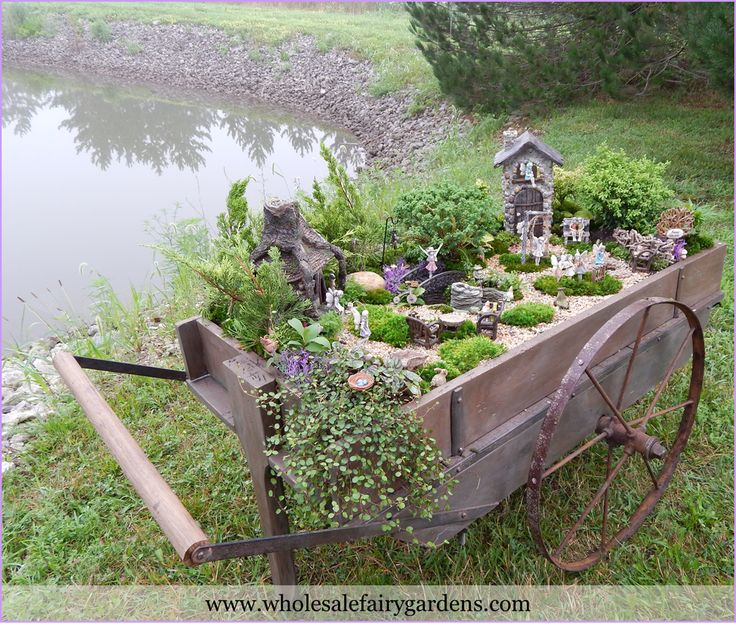 Fairy Garden Container Ideas the options for these adorable fairy gardens are endless with only a few materials and This Wheelbarrow Made A Great Container To Build A Fairy Garden Community In