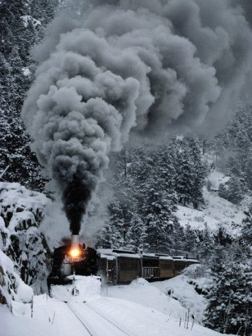 A Train Chugs Through the Snow Blanketing the San Juan Mountains Fotoprint van Paul Chesley - bij AllPosters.be