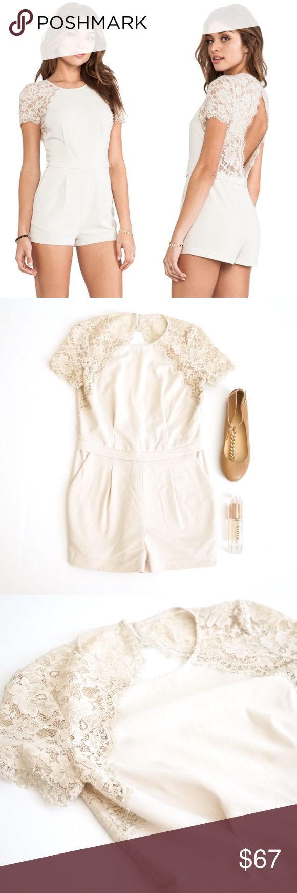 BCBGMaxazria Lace Open Back Romper Gorgeous romper jumpsuit by BCBG. Size 0. Great condition. Super classic style with fitted pleats, pockets, short sleeves and an open keyhole back, lace trim. Retailed for $228. Pale neutral color that will go with everything you wear! Worn once and in good condition. BCBGMaxAzria Pants Jumpsuits & Rompers