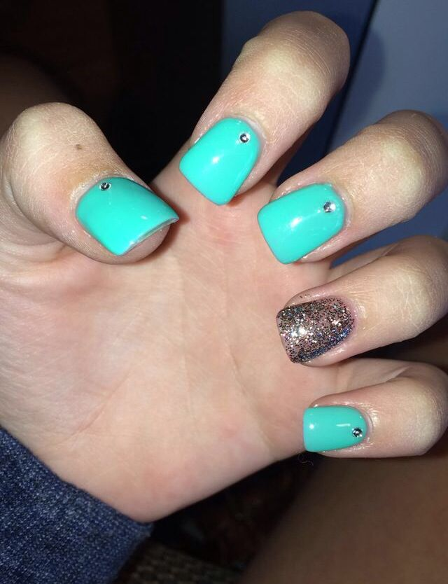 Teal Acrylic Nails With Rhinestones And Glitter Nails
