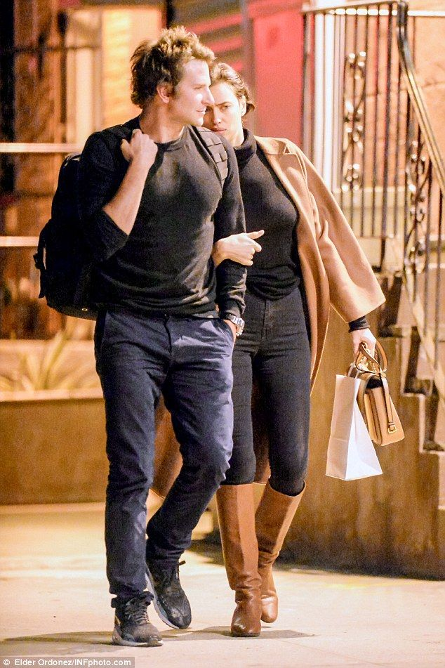 Cover me! Irina Shayk looked shy on Friday evening in NYC as she hid behind boyfriend Bradley Cooper