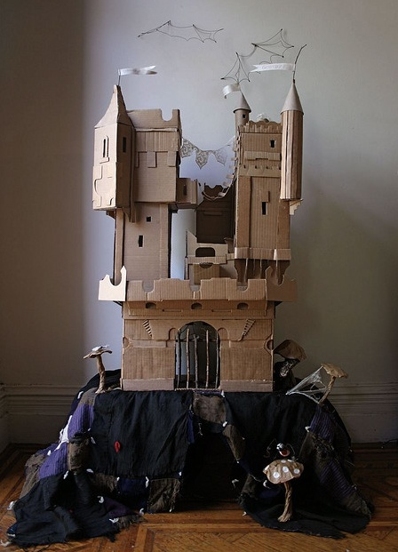Oh to be a paper doll inhabiting this cardboard castle.  By artist Ann Wood.
