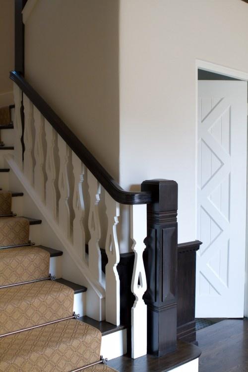 door, stair carpet, spindles, color contrast