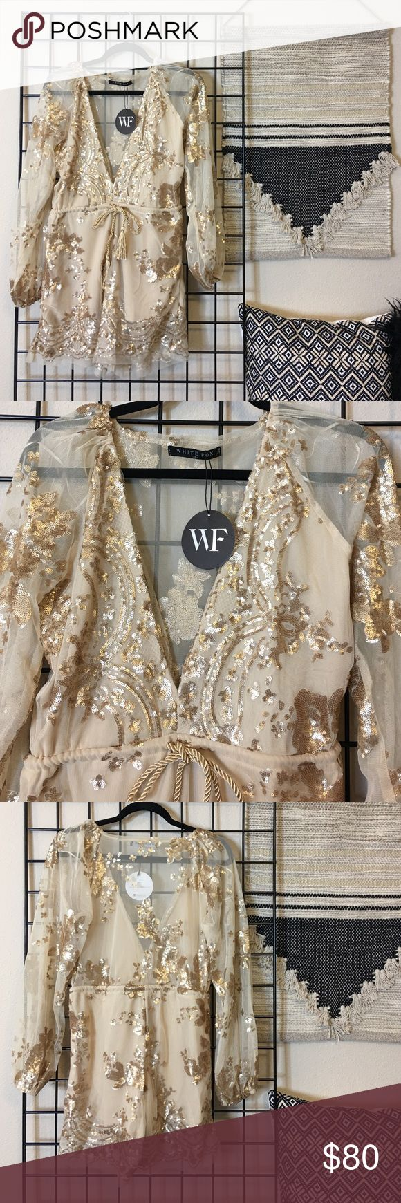 NWT White Fox Boutique Gold Playsuit Brand New with tags. Never worn. Recently purchased. Gold sequin embellished romper from White Fox Boutique. Size XS but fits like a S. I'm 5'2, 25in waist and it's big on me. Low cut front and rope tie around waist. white fox boutique Dresses Long Sleeve