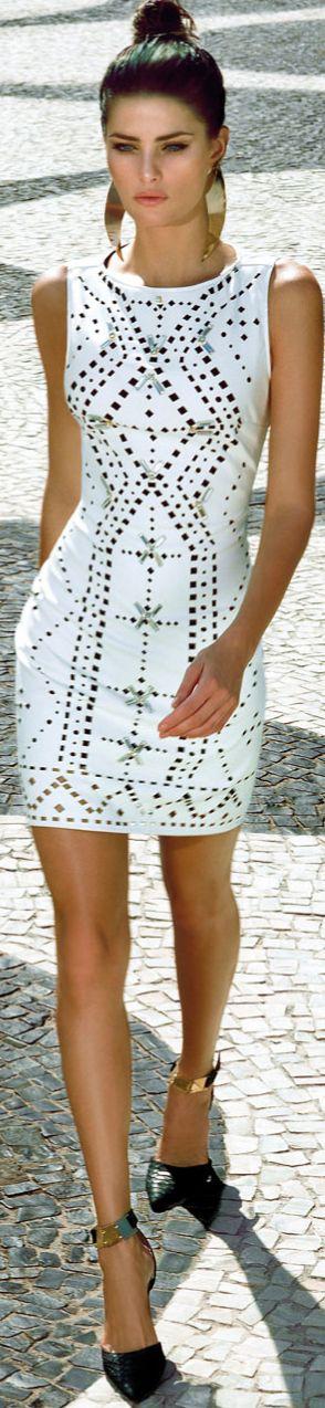 Gorg head to toe. Gorgeous white dress + gold statement earrings + gold cuffed black  heels