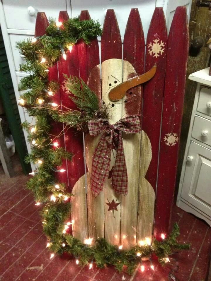 Snowman on fence OR make our own fence by nailing rustic pallet boards together!