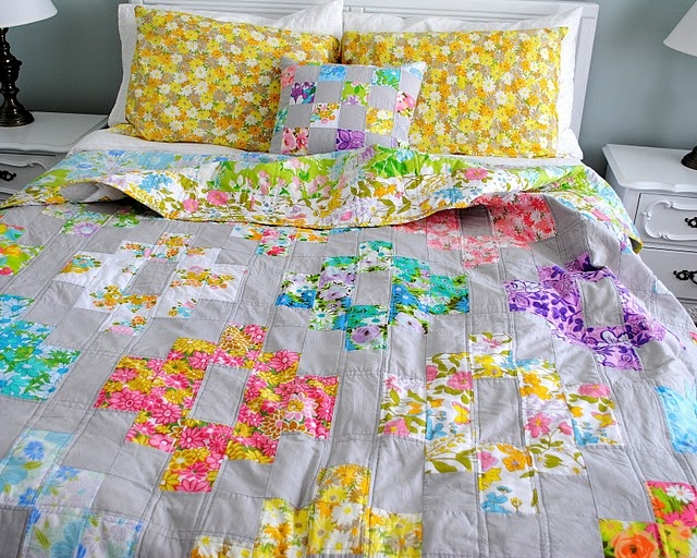 Beautiful quilt with vintage fabrics, set off by a Kona Ash solid.