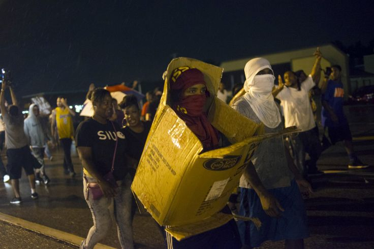 The Coming Race War Won't Be About Race by Kareem Abdul-Jabbar - Protestors march on Florissant Ave. in Ferguson, Mo.