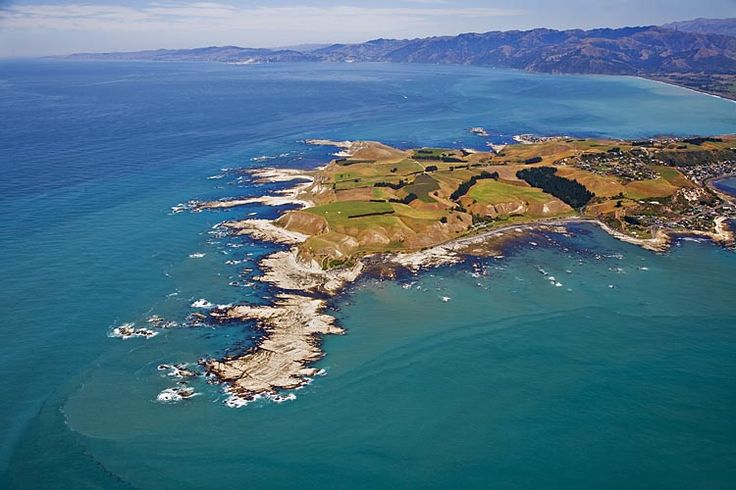 The rocky tip of Kaikoura Peninsula, looking south down the coast,  see more at New Zealand Journeys app for iPad www.gopix.co.nz
