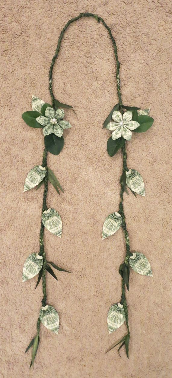 Beautiful money lei made with money flowers and money leaves. Perfect for graduations, weddings, and more!