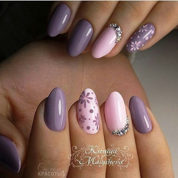 The Royal Spring. Get your nails look royal with this piece of art on your nails, the spark of glitter, the glow of diamonds and the touch of glossy purples makes this nail art design for royal spring perfect.