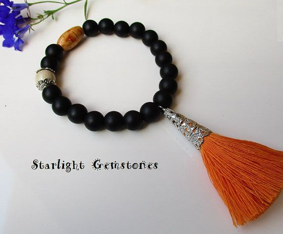 Boho Chic Black Obsidian and Riverstone Matte Gemstone Bracelet with Orange Tassel and Wooden Bead. $33 AUD