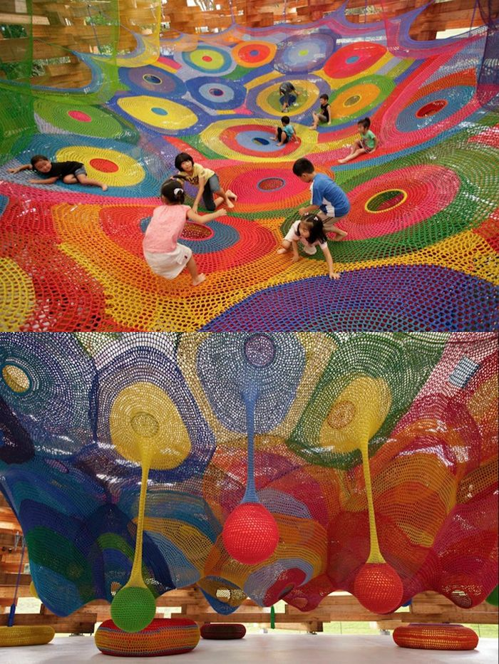 Japanese artist, Toshiko Horiuchi-MacAdam and her husband, Charles MacAdam conceive and construct these amazing textile playgrounds out of crocheted strings of nylon.    This one is set up at the Hakone Open Air Museum in Hakone, Japan. Vibrant colours, mysterious pockets to explore, and distant heights to reach – these landscapes are whimsical, outlandish, and appear to have jumped right out of a Dr. Seuss book.