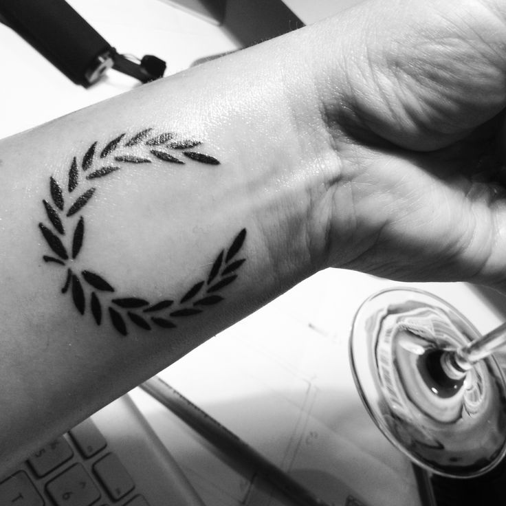 Minimal tattoo laurel wreath