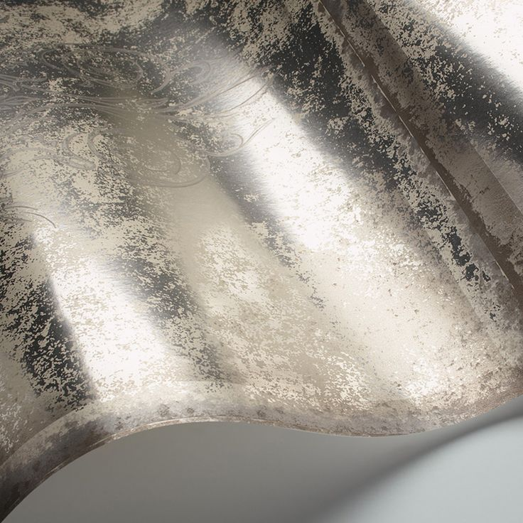"This design offers a modern twist on the trend for antique decorative glass, using ornamental elements from the Cole & Son archive to create a bevelled mirror wallpaper pattern. Printed on a foil backing, this design comes in six subtle reflective shades of aged silvers, rusted bronze, faded blues and amethyst.  Albery ROLL SIZE is 10.05m Height x 53cm (20.86"") wide, Repeat 53cm (20.86"")  Composition: 100% Paper  Use: Wallpapers  Delivery time: if in stock 1 week (in Europe) (P..."