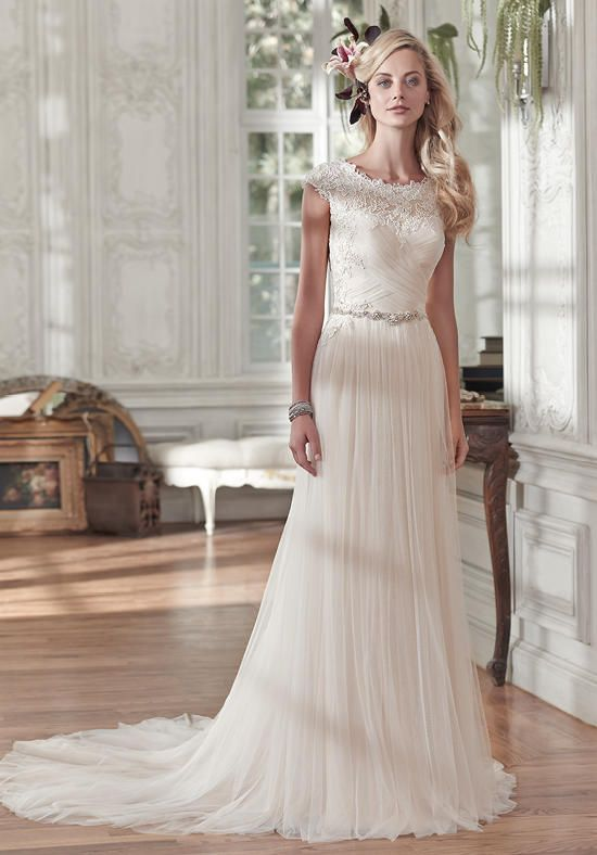 Tulle gown with ruching bodice, cap sleeves, and beaded lace embellishments I Style: Patience Marie I by Maggie Sottero I https://www.theknot.com/fashion/patience-marie-maggie-sottero-wedding-dress?utm_source=pinterest.com&utm_medium=social&utm_content=aug2016&utm_campaign=beauty-fashion&utm_simplereach=?sr_share=pinterest