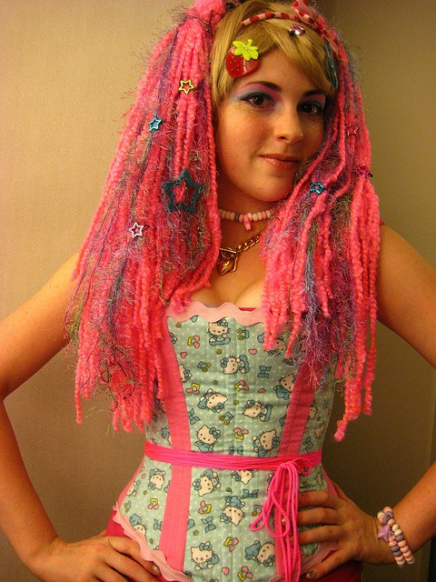 Stumbled across her on google. The outfit is hideously girly that its awesome.
