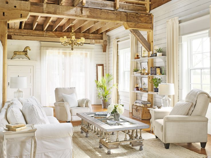 Beautifully light and bright!  I love the beams and so many times you see beamed rooms that are dark - love this...