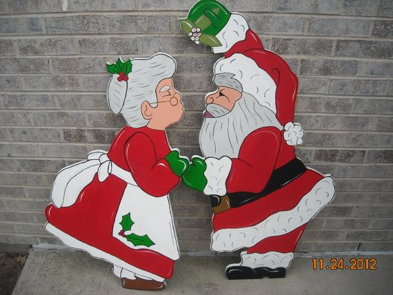 Christmas Kiss under the Mistletoe with Santa and the by chardoman