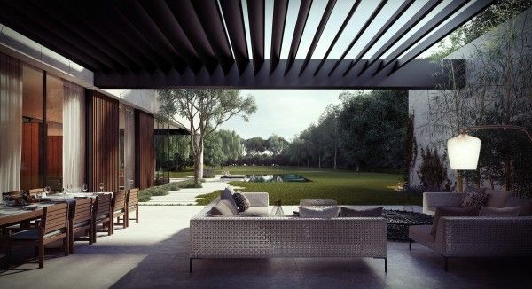 Pergola stretches from house to wall. Angled for allowing seasonal light through and shade in summer