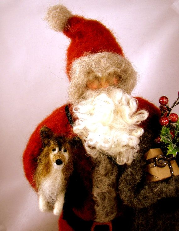 needle felt Santa.  Santa looks like he's holding our dear pup Buster.  Rest in Peace little one.