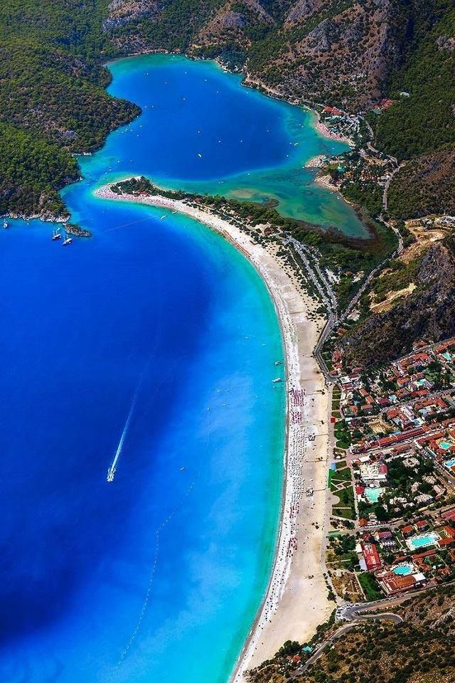 Blue Lagoon, Ölüdeniz. Ölüdeniz is a resort village on the southwest coast of Turkey. It's known for the blue lagoon of Ölüdeniz Tabiat Parkı and the wide, white Belcekız Beach. Overlooking the village is Babadağ mountain from where paragliders take to the skies. The Lycian Way is a long-distance marked footpath starting in Ölüdeniz, and has coastal views. To the south, Butterfly Valley is a nature reserve with a secluded bay. (V)