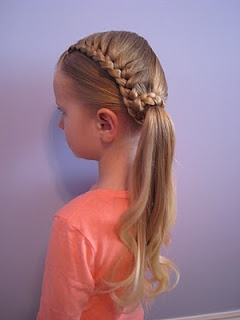 Fun little half french wrap ponytail.  I need to learn how to french braid...