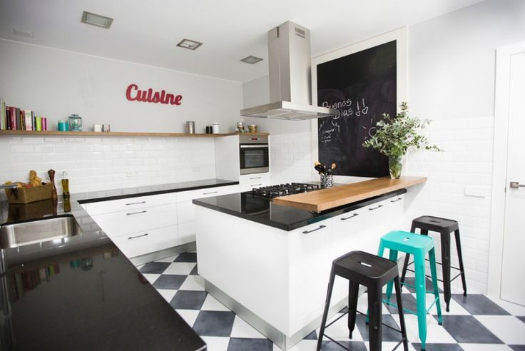 urban industrial kitchen idea with single open shelf mounted on white walls black solid countertop wooden top breakfast bar colorful bar stools black white tiles floors of Dislike Mainstream Kitchen Shelving? These Tens Industrial Kitchen Shelving Ideas Might Be Your Favorite