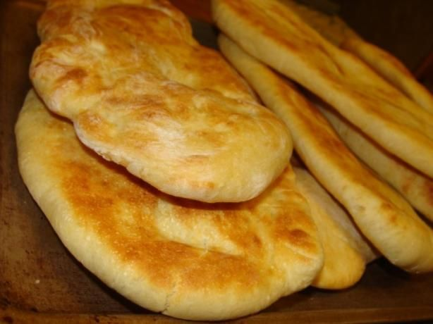Easy Naan (Bread Machine) from Food.com: Yummy Indian naan bread .. Goes great with curries etc .. very easy to make since the bread machine does all the work! Try adding spices, or use whole wheat flour instead of white ..